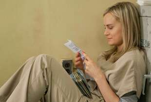 "Taylor Schilling in a scene from Netflix's ""Orange is the New Black"" Season 2. Photo credit: JoJo Whilden for Netflix."