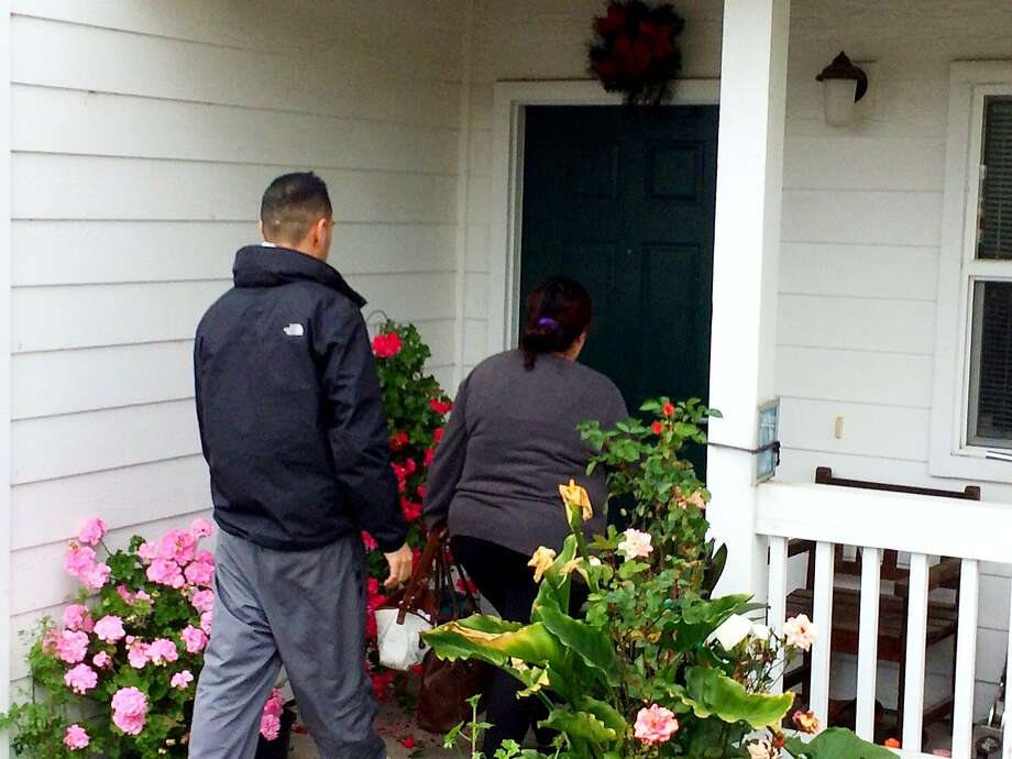 The aunt of 18 year-old Yanira Serrano enters Serrano's home in Half Moon Bay on Wednesday morning.  Serrano, armed with a knife, was shot and killed Tuesday night by a San Mateo County sheriff's deputy. Photo: Kurtis Alexander, The Chronicle