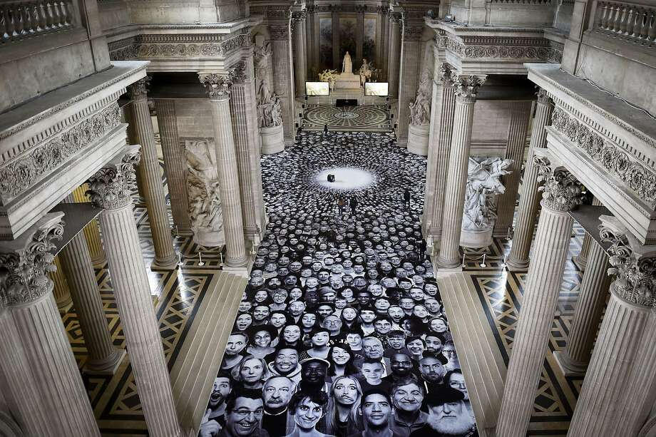 "A photographic salute to the people: A montage by photographer JR is displayed on the floor of the Pantheon, a secular temple in Paris that contains the remains of distinguished French citizens. The Centre des Monuments Nationaux chose JR to create a participatory work inspired by his ""INSIDE OUT"" project. Photo: Martin Bureau, AFP/Getty Images"