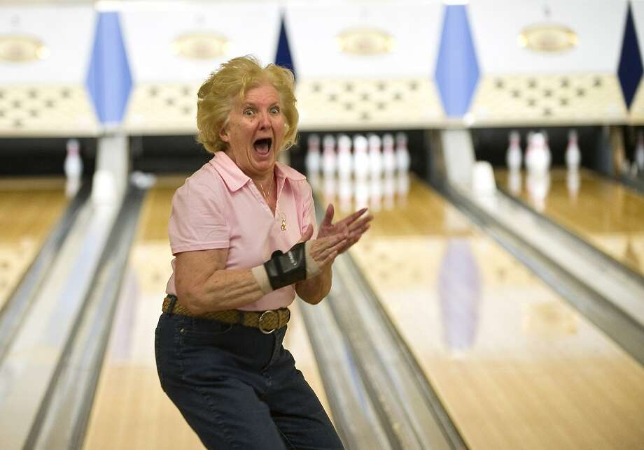 Pin buster: Joyce Tedrow, 72, of Zion, Pa., has either bowled a strike or just won the lottery in Bellefonte, Pa. Photo: Nabil K. Mark, Associated Press