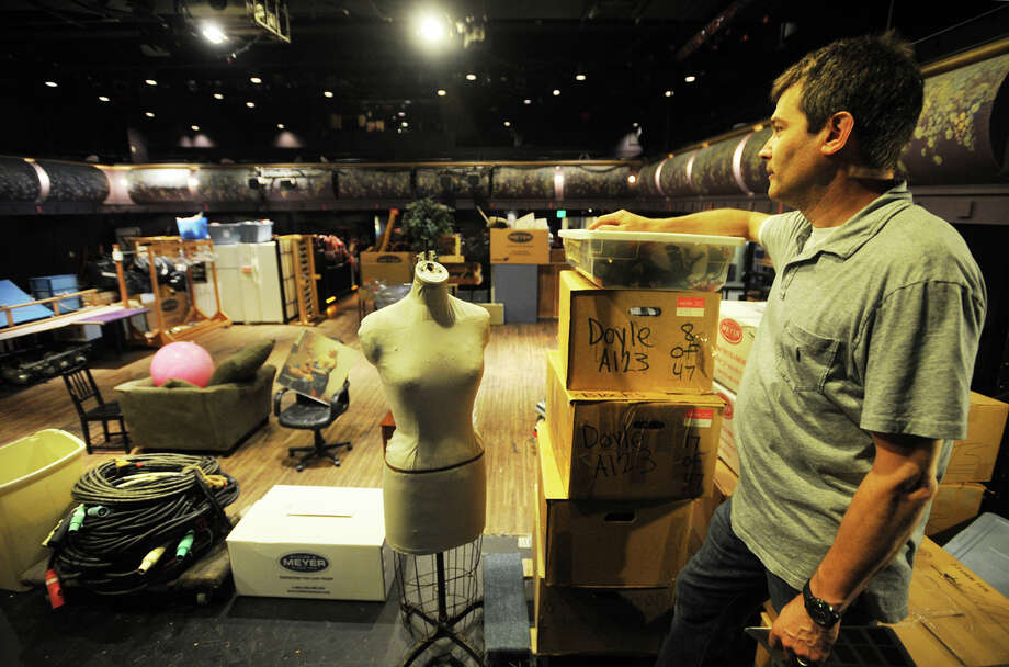 Hugh Hallinan, executive director of the Downtown Cabaret Theatre, supervises the moving of items in preparation for asbestos abatement which will close the theater until October on Wednesday, June 4, 2014. Photo: Brian A. Pounds / Connecticut Post