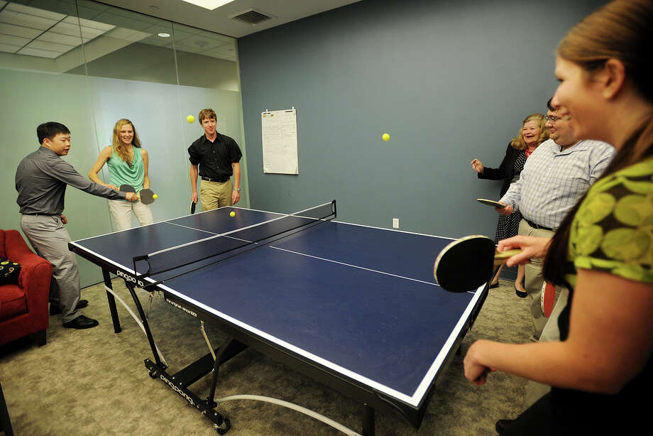 Employees enjoy a casual workplace environment including a pingpong table at startup ZetrOZ, Inc., manufacturers of a portable ultrasound treatment device, in Trumbull, Conn. on Wednesday, June 4, 2014. Photo: Brian A. Pounds / Connecticut Post