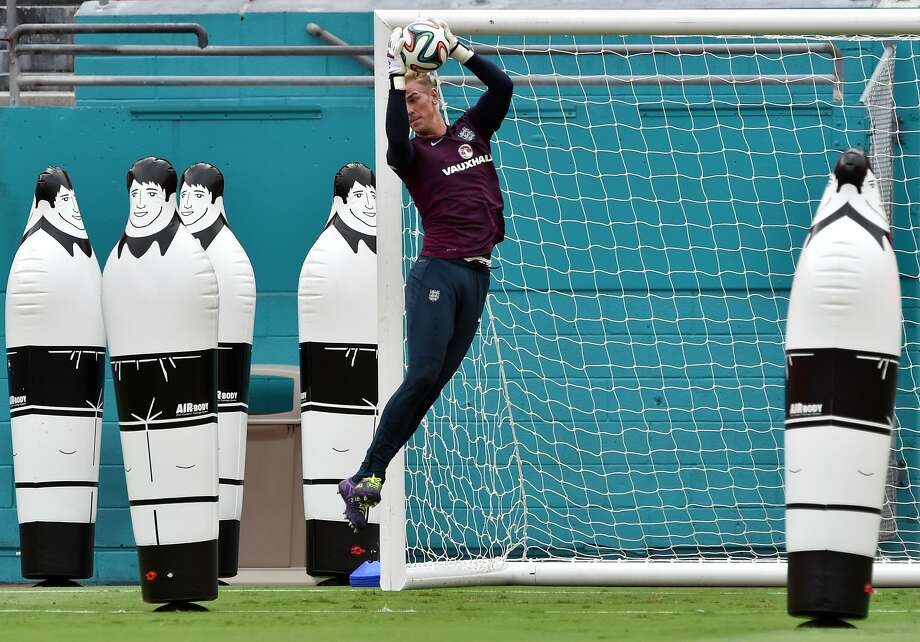 The volley of the dolls:So far not a single inflatable soccer player has scored on England goalkeeper Joe Hart during practice at Miami Sun Life Stadium. England's World Cup team is training in Florida in order to get accustomed to the steamy weather expected in Brazil. Photo: Mladen Antonov, AFP/Getty Images