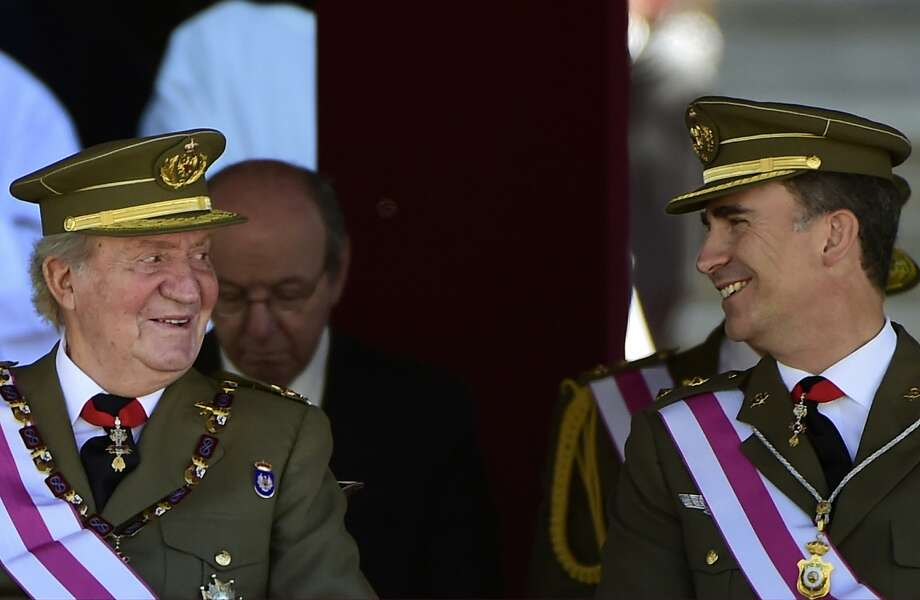 The king is exiting, long live the king:Spanish King Juan Carlos and Crown Prince Felipe share a smile during a military ceremony marking the bicentennial of the Royal and Military Order of Saint Hermenegild in El Escorial. Juan Carlos announced he would abdicate in favor of Felipe, prompting a spate of anti-royalist protests. Photo: Pierre-Phillippe Marcou, AFP/Getty Images