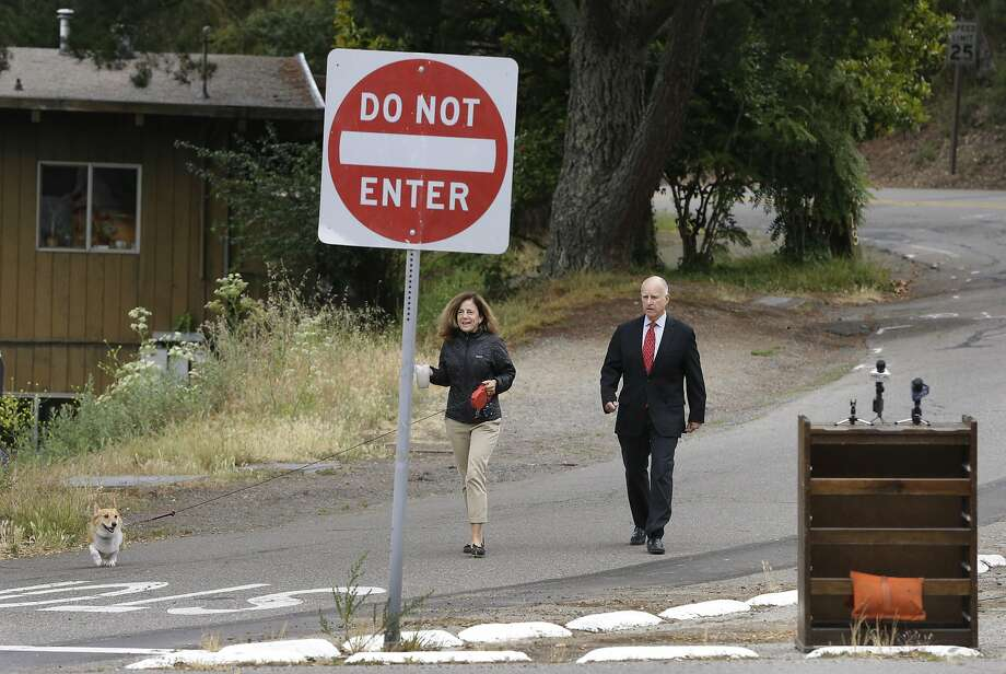 And to check out the lovely Craigslist free-ad chest:Gov. Jerry Brown, wife Anne Gust and dog Sutter arrive to vote Tuesday in Oakland. Photo: Ben Margot, Associated Press