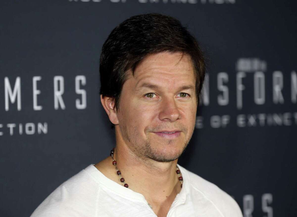Actor Mark Wahlberg poses for a photo on the red carpet premiere of his new movie Transformers: Age of Extinction in Sydney Australia Wednesday, May 21, 2014, (AP Photo/Rob Griffith) ORG XMIT: XRG103