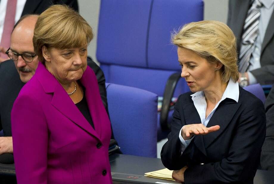 German Chancellor Angela Merkel (left) chats with Defense Minister Ursula von der Leyen at parliament in Berlin. Photo: John Macdougall, AFP/Getty Images