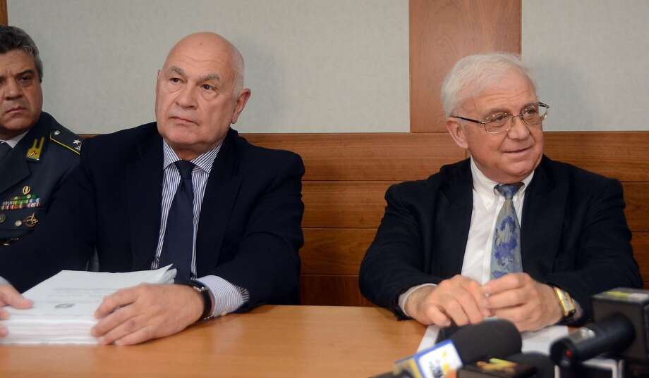 "Prosecutors Carlo Nordio, left, and Luigi Delpino meet the media during a news conference in Venice, Italy, Wednesday, June 4, 2014. Venice's mayor and more than 30 other people were arrested Wednesday in a sweeping corruption scandal in which politicians are accused of financing election campaigns with some 25 million euros ($34 million) in bribes from the consortium building underwater barriers to protect the lagoon city from flooding. One of a series of bribery probes into major public works projects in Italy, the web of alleged bribery revealed in Venice has many of the same characteristics as Italy's ""Kickback City"" scandal of 20 years ago that toppled an entire political class. ""There are even some of the same players,"" prosecutor Carlo Nordio, who was involved in the 1990s investigations, told a news conference. ""This system, however, is much more sophisticated and much more difficult to discover."" (AP Photo/Luigi Costantini) Photo: Luigi Costantini, Associated Press"