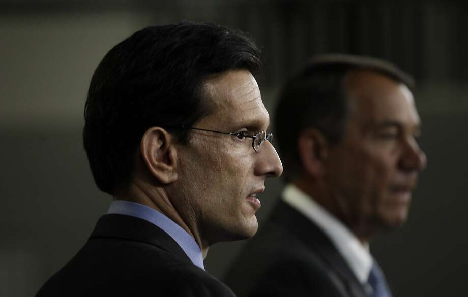 Majority Leader Eric Cantor, R-Va., and House Speaker John Boehner, R-Ohio, speak about repealing President Obama's health care law in 2011. Photo: Charles Dharapak, Associated Press