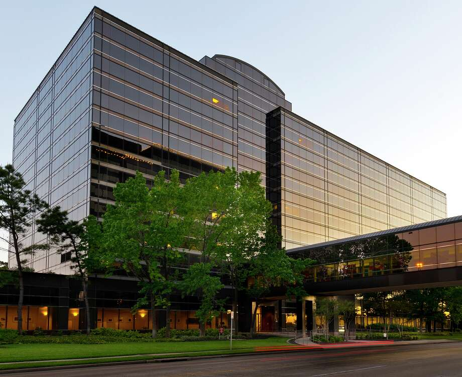 Exxon Mobil Corp. has parted with the eight-story Eight Greenspoint Plaza. The oil giant is consolidating its workforce at a site south of The Woodlands. Photo: Courtesy Of JLL / ©2013 Jerry Jones