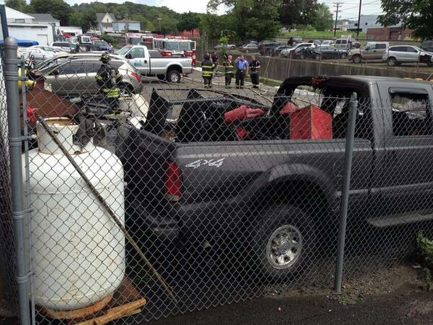 The truck was parked up next to a large propane tank. It was not immediately clear what was in the truck's bed.
