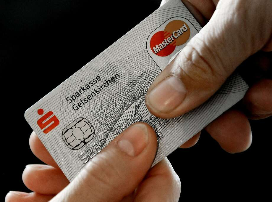FILE - In this Nov. 18, 2009 file photo, a Mastercard chip-based credit card is posed for a photo in Gelsenkirchen, Germany. In the wake of recent high-profile data breaches, including this week's revelation that hackers stole consumer data from eBay's computer systems, Visa and MasterCard are renewing a push to speed the adoption of microchips into U.S. credit and debit cards. (AP Photo/Martin Meissner, File) Photo: Martin Meissner, Associated Press