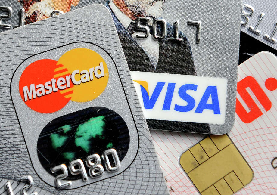 For whatever reason, retailers appear to be having a hard time making their new systems compatible with chip debit cards. Photo: Martin Meissner / Associated Press / AP