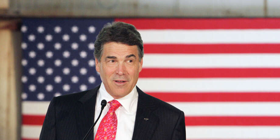 Outgoing GOP Gov. Rick Perry, who many expect to make another presidential run, will open the 11,000-delegate GOP convention in Fort Worth. Photo: Jim Cole, AP / AP