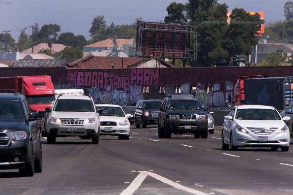 Graffiti lines buildings and overpass support pillars along Interstate 880 between 16th and Fruitvale avenues in Oakland, Calif. on Wednesday, June 4, 2014.