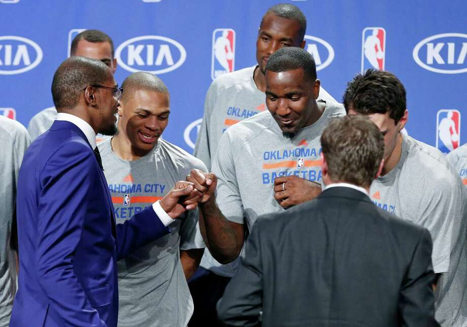 Oklahoma City Thunder's Kevin Durant, left, celebrates with teammates Russell Westbrook, center, and Kendrick Perkins, right, following the announcement that Durant is the winner of the 2013-14 Kia NBA Basketball Most Value Player Award in Oklahoma City, Tuesday, May 6, 2014. (AP Photo/Sue Ogrocki) Photo: Sue Ogrocki, STF / AP