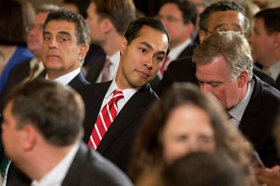 "Housing and Urban Development Secretary nominee, current San Antonio Mayor Julian Castro, center, attends a Joining Forces initiative event where first lady Michelle Obama announced ""The Mayors Challenge to End Veteran Homelessness"" program, Wednesday, June 4, 2014, in the East Room of the White House in Washington. (AP Photo/Jacquelyn Martin) Photo: Jacquelyn Martin, Associated Press / AP"