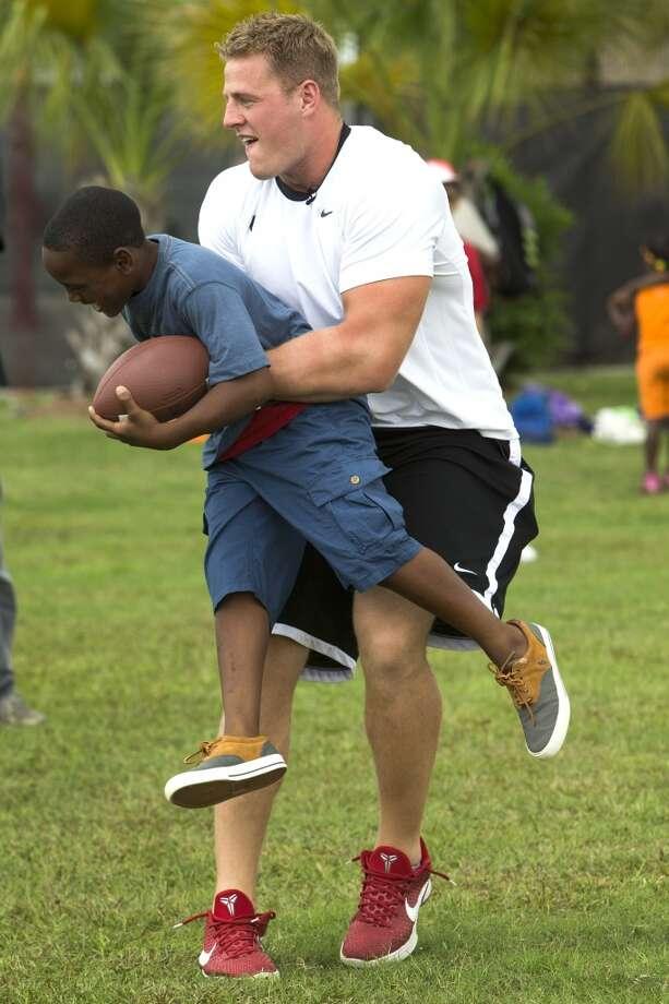 J.J. Watt spins Trayveon Richard around. Photo: Brett Coomer , Houston Chronicle