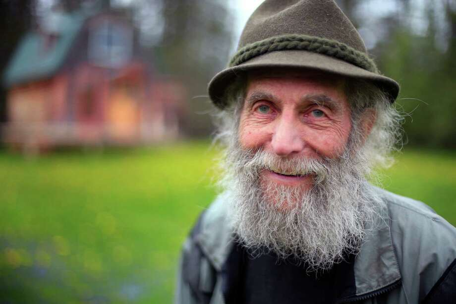 In this photo taken on Friday, May 23, 2014, Burt Shavitz poses on his property in Parkman, Maine. Shavitz, the Burt behind Burt's Bees, still lives in rural Maine after leaving the company that was later sold for millions by his former business partner, Roxanne Quimby. He said he has no regrets, and that he doesn't need much. (AP Photo/Robert F. Bukaty) ORG XMIT: MERB201 Photo: Robert F. Bukaty / AP