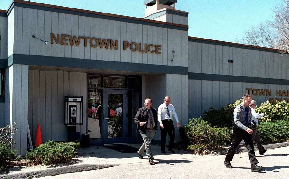 Detectives and a police sergeant leave the Newtown police station in this file photo. Photo: File Photo / The News-Times File Photo