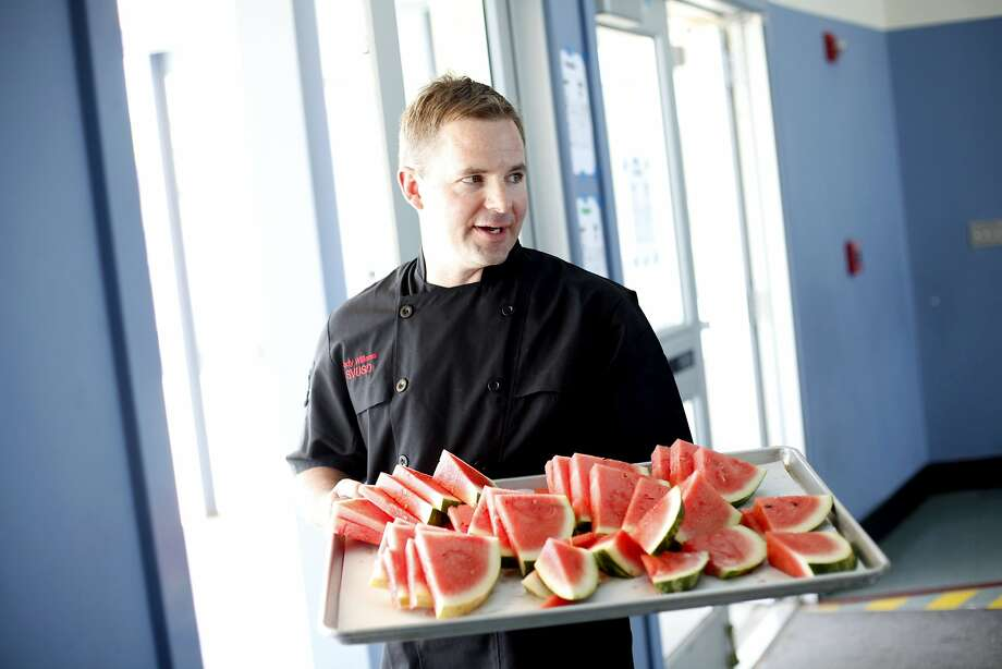 In the Sonoma Valley Unified School District, Cody Williams provides fresh watermelon for the students' lunches at Adele Harrison Middle School. He also bakes fresh bread daily and serves local strawberries. Photo: Sarah Rice, Special To The Chronicle
