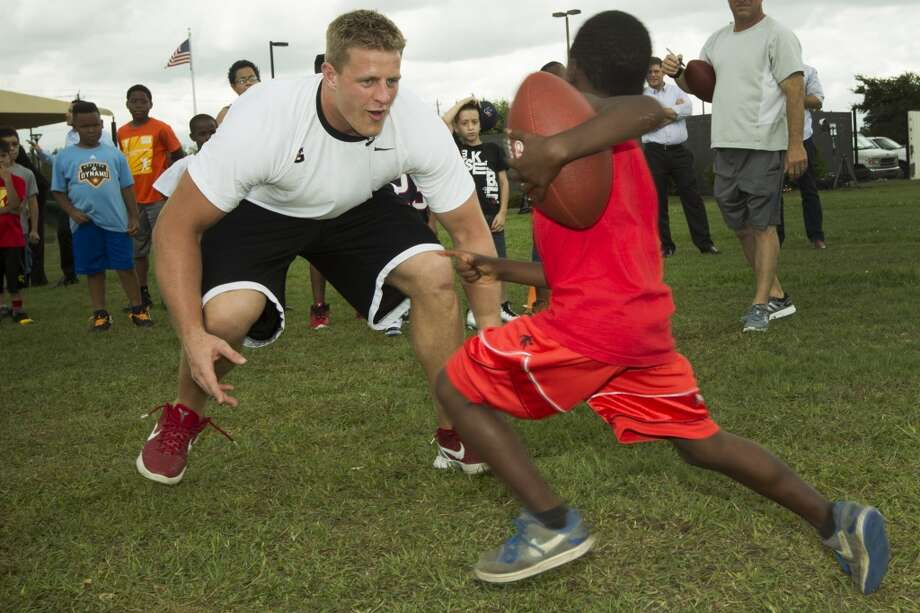 "J.J. Watt, left, lines up to ""tackle"" tackle Isiah Jones. Photo: Brett Coomer , Houston Chronicle"