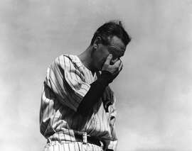 """** ADVANCE FOR WEEKEND EDITIONS, JULY 5-6 -- FILE -- ** In this July 4, 1939 file photo, New York Yankees' Lou Gehrig, the """"Iron Horse"""", wipes away a tear during a sold-out tribute at Yankee Stadium in New York.  From Ruth and Gehrig to DiMaggio and Mantle, to Jackson and Jeter, Yankee history is crowded with dynamic players flourishing in a ballpark whose roots date back to a bitter rivalry that was spiced with spite.  (AP Photo/Murray Becker, File)"""