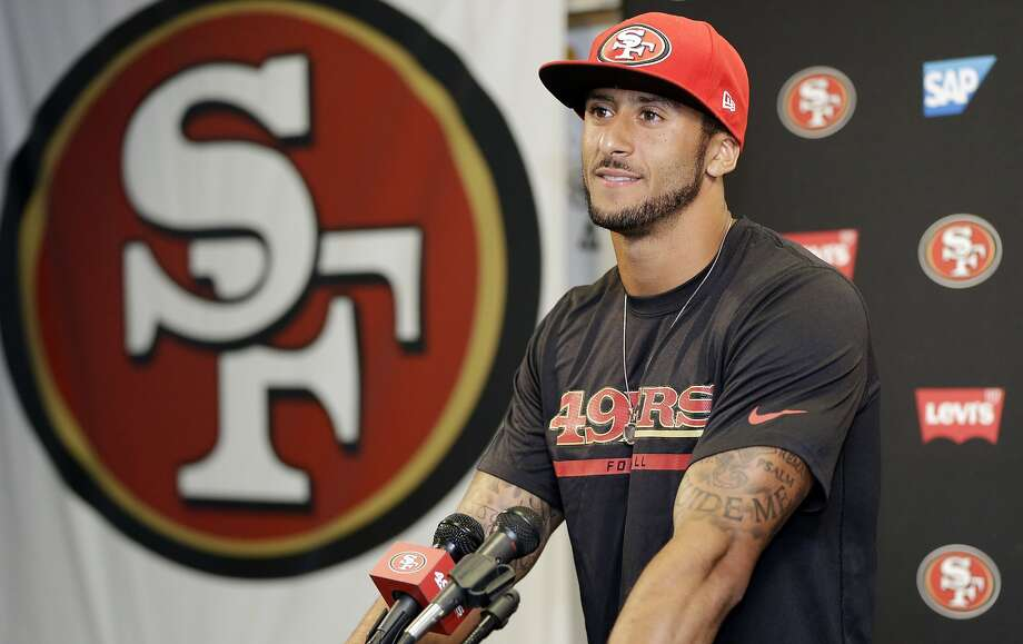 San Francisco 49ers quarterback Colin Kaepernick answers question during an NFL football press conference on Wednesday, June 4, 2014, in Santa Clara, Calif. Kaepernick received a new six-year contract extension Wednesday that keeps him with the franchise through the 2020 season. (AP Photo/Marcio Jose Sanchez) Photo: Marcio Jose Sanchez, Associated Press