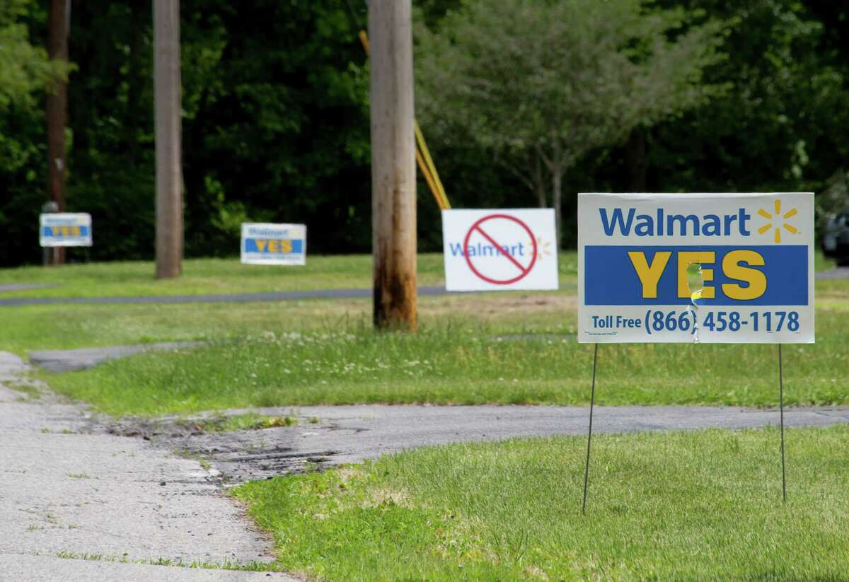 Signs demonstrating pro and anti views of the plan to build a new Wal-Mart in the village of Ballston Spa can be seen in numerous yards around the area on Wednesday, June 4, 2014 in Ballston Spa, N.Y. (Tom Brenner/ Special to the Times Union)