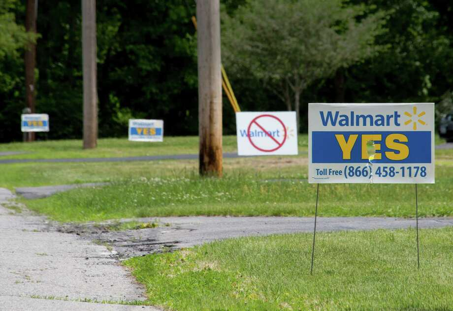 Signs demonstrating pro and anti views of the plan to build a new Wal-Mart in the village of Ballston Spa can be seen in numerous yards around the area on Wednesday, June 4, 2014 in Ballston Spa, N.Y. (Tom Brenner/ Special to the Times Union) Photo: Tom Brenner / ©Tom Brenner/ Albany Times Union