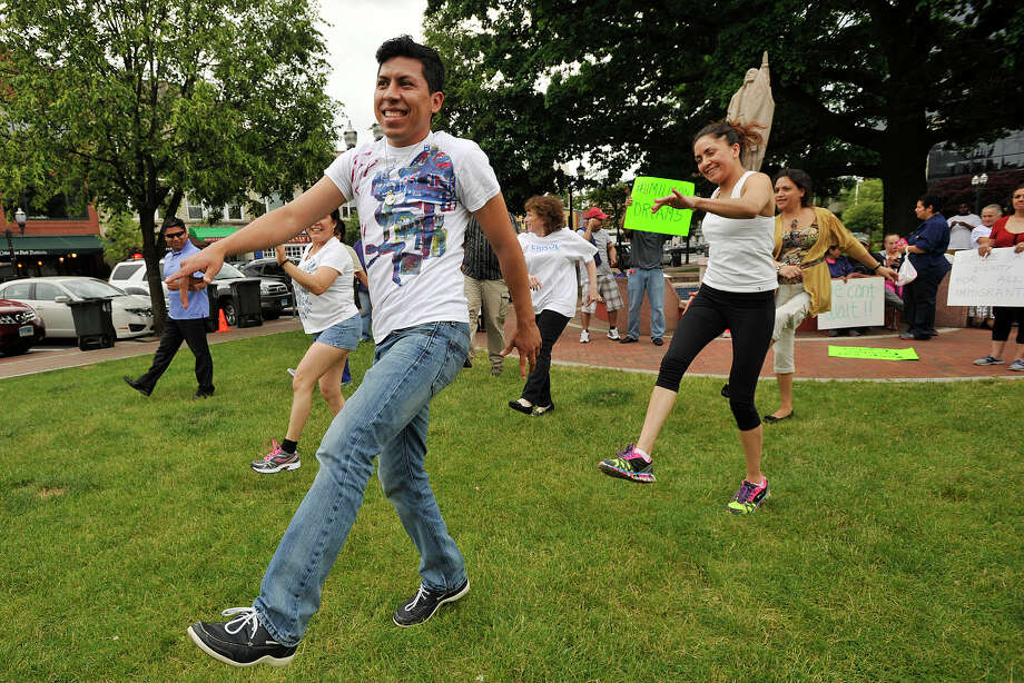 Rene Soto, left, with Quetzal Group, dances during a flash mob rally for immigration reform at Columbus Park in Stamford, Conn., on Wednesday, June 4, 2014. Photo: Jason Rearick / Stamford Advocate