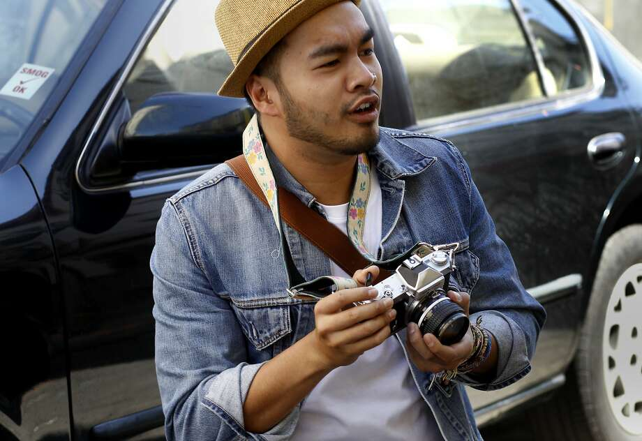 Rey Cayetano took up photography as a tribute to a friend who was killed by a car before he could give her the gift of a camera. Photo: Brant Ward, The Chronicle