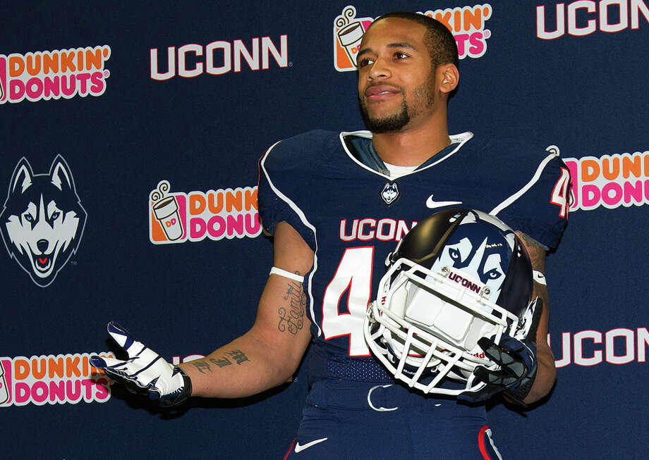 In this Thursday, April 18, 2013, photo provided by the University of Connecticut, UConn's Lyle McCombs models the school's new NCAA college football uniform in Storrs, Conn. The new uniform comes out of a marketing partnership between the school's athletic department and Nike, which helped design it at no cost to the school. (AP Photo/University of Connecticut, Stephen Slade) Photo: Stephen Slade, Associated Press / Associated Press