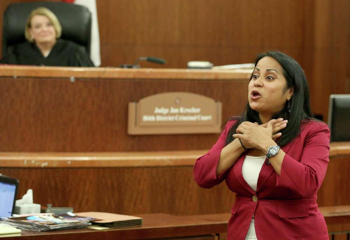 Assistant DA Jamie Reyna explains in the closing arguments how Mark Castellano choked Michelle Warner. Judge Jan Krocker listens in the background. Castellano says he killed Warner in self-defense.