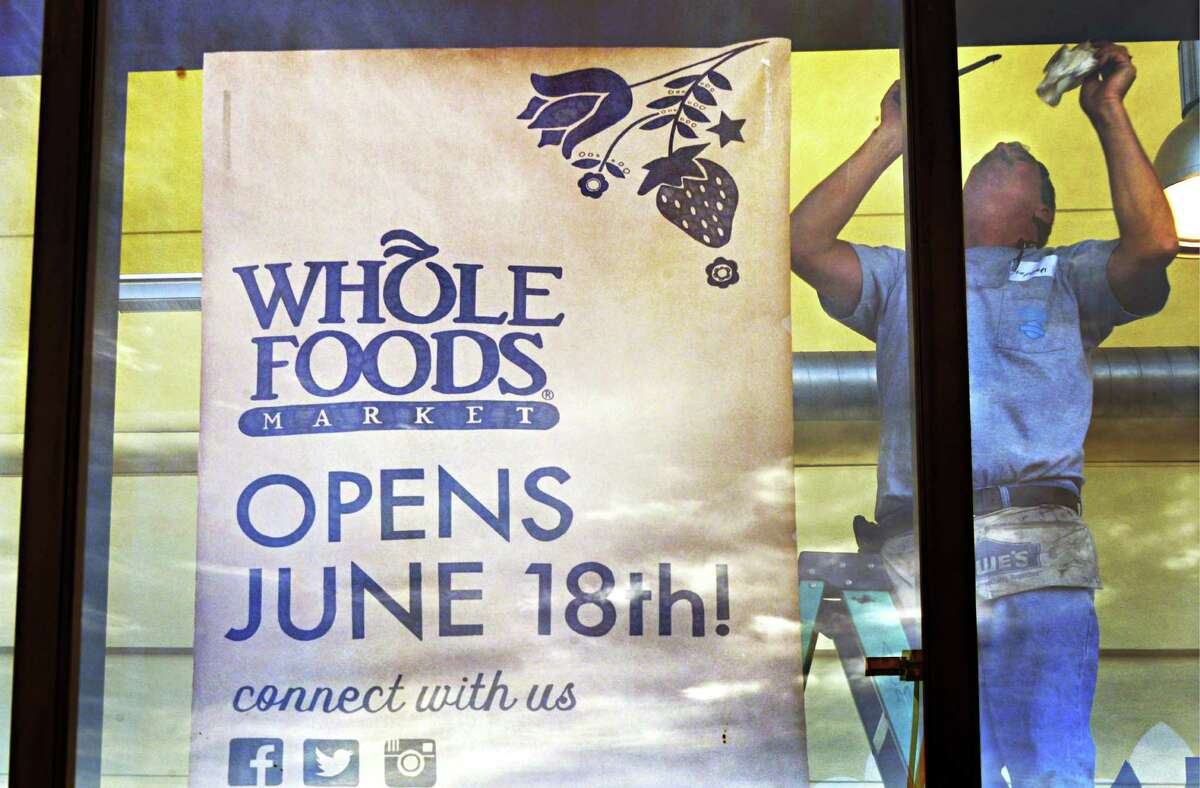 Steve Wilsey of AGM caulks windows at the Whole Foods store at Colonie Center Wednesday, June 4, 2014, in Colonie, N.Y. (John Carl D'Annibale / Times Union)