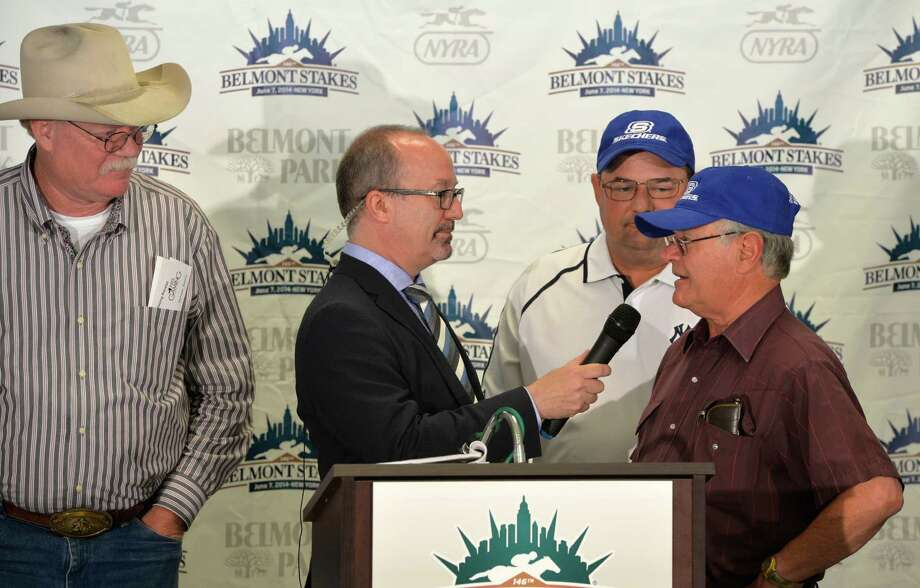 California Chrome's Owner Steve Coburn, left and his trainers Alan and Art Sherman, right, are interviewed by NYRA TV personality Andy Serling, center at the Post Position Draw held Wednesday morning June 4, 2014 at Belmont Park in Elmont, N.Y.   According to trainer Art Sherman, California Chrome has the same position in the starting gate in all three races that Triple Crown winner Secretariat had. (Skip Dickstein / Times Union) Photo: SKIP DICKSTEIN