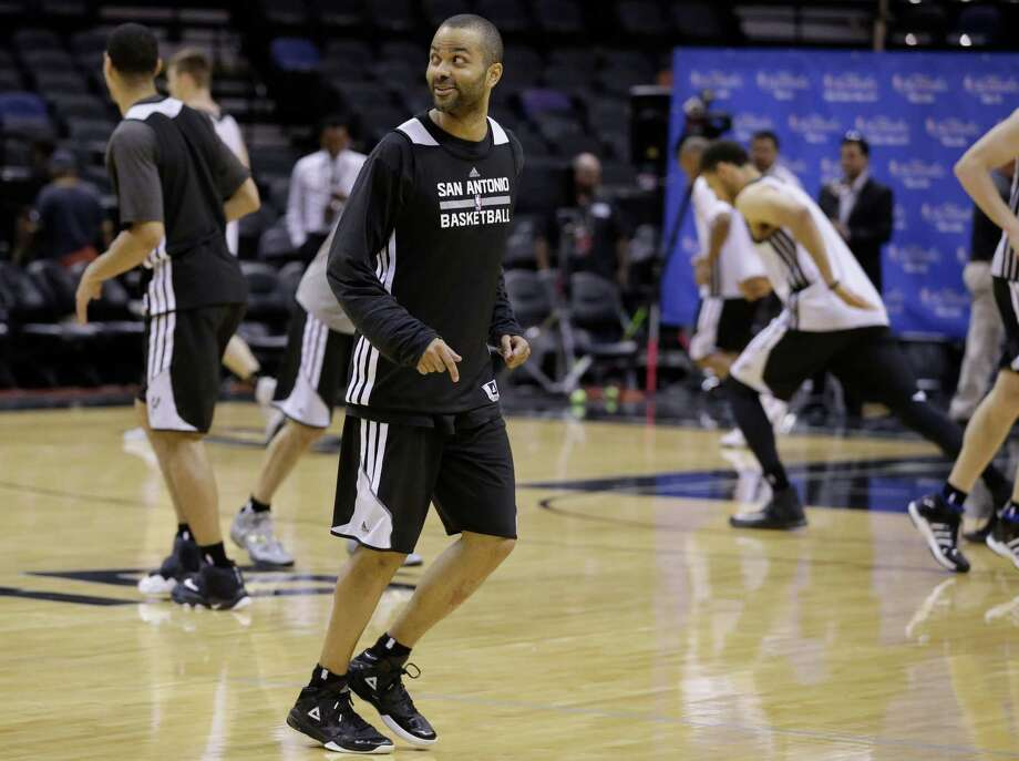 San Antonio Spurs guard Tony Parker warms up for basketball practice on Wednesday, June 4, 2014 in San Antonio. The Spurs play Game 1 of the NBA Finals against the Miami Heat on Thursday. (AP Photo/Tony Gutierrez)  ORG XMIT: TXKJ114 Photo: Tony Gutierrez / AP