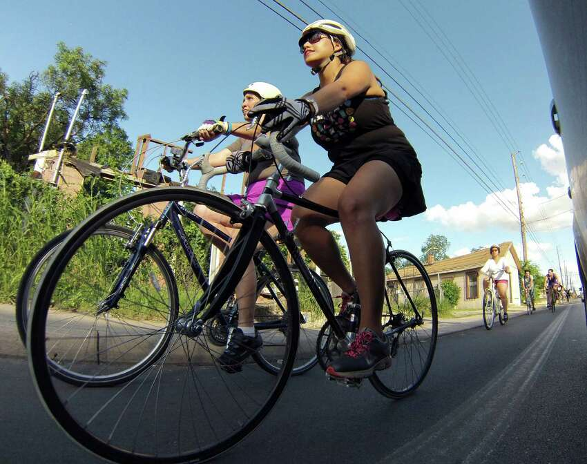 Bicyclists ride along South Flores Street in response to San Antonio City Council's decision to remove lanes from the street on Wednesday, June 4, 2014.