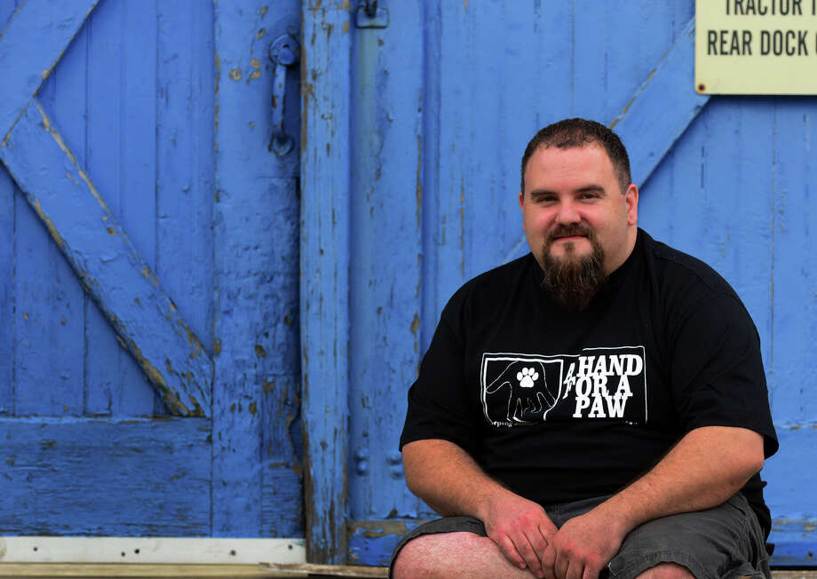 Jimmy Gonzalez poses in front of Electric Maintenance Service Compnay on Bennett Street in Bridgeport, Conn. on Wednesday June 4, 2014. Gonzalez will have a grand opening on June 13th for a new non-profit animal resource center called A Hand For a Paw. EMS is renting out a small area in their building for his operation. Photo: Christian Abraham / Connecticut Post