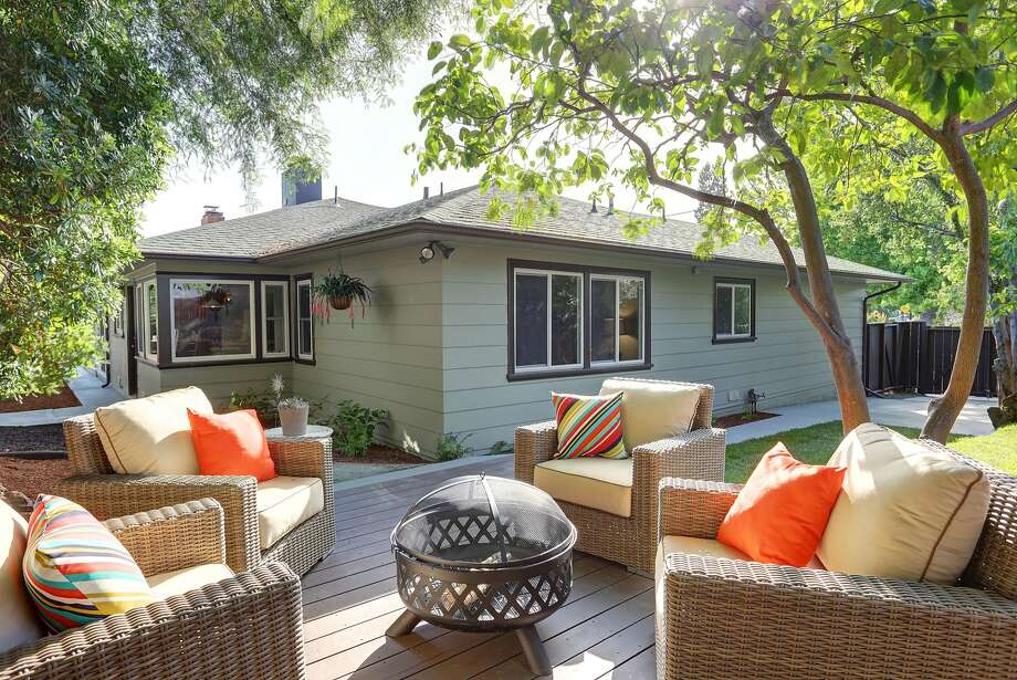 The backyard at 4030 Laguna Ave. in Oakland includes a deck and shade trees. Photo: Liz Rusby/The Grubb Co.