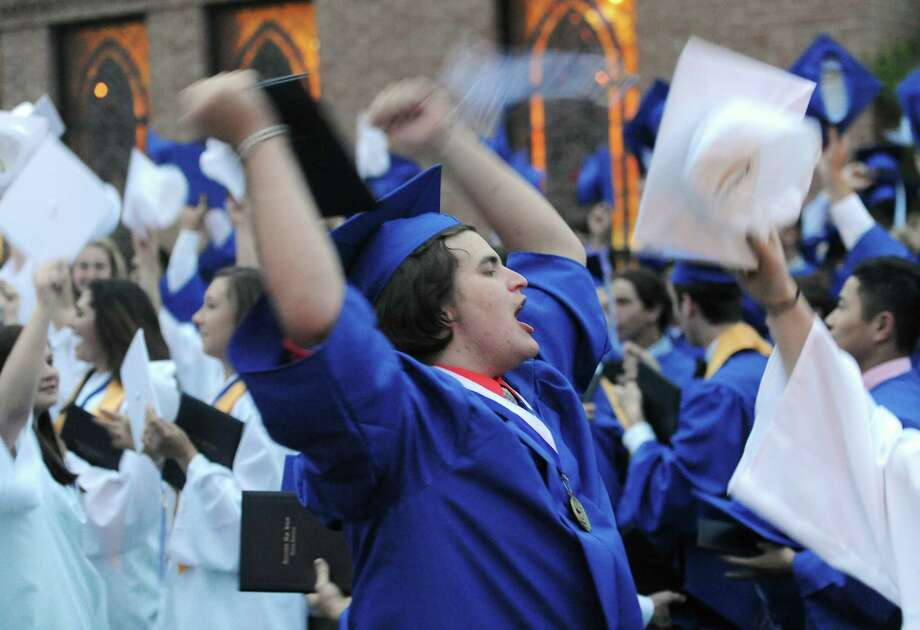 New graduate Alessandro DiPierro celebrates with his classmates at the Immaculate High School 2014 Graduation Ceremony at Church of St. Mary in Bethel, Conn. Wednesday, June 4, 2014. Photo: Tyler Sizemore / The News-Times