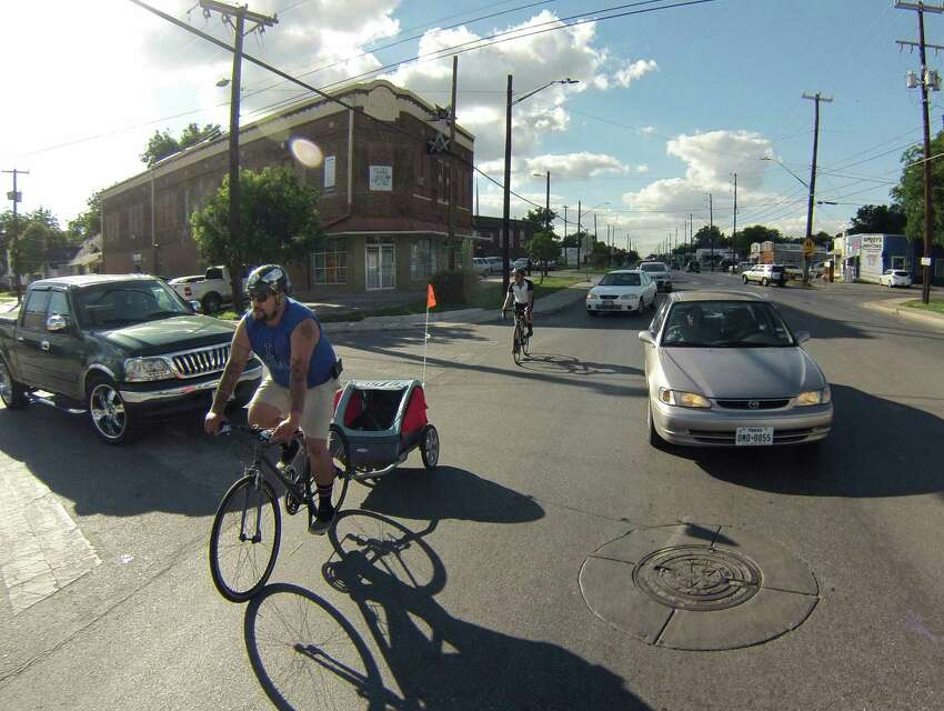 Bicyclists ride along South Flores Street in response to San Antonio City Council's decision to remove bike lanes from the street on Wednesday, June 4, 2014.