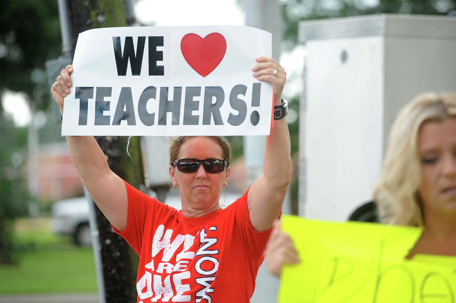 Several teachers and supporters gathered Wednesday at Rogers Park to protest the possible BISD layoffs directed at educators. Several cars passing by honked their horns and waved in support of the educators.
