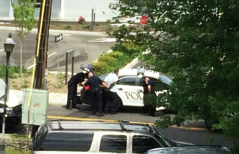 A man -- later identified by police as Nelson Rivera, 35, of East Main Street, Bridgeport -- is taken into custody Wednesday after a chase by Westport and Fairfield police at Post and Sasco Hill roads in Fairfield to face multiple charges filed by Westport police. Photo: Meghan Doody / Westport News