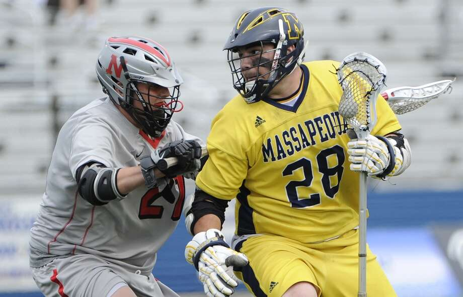 Massapequa attacker Paul Dilena is pressured by Niskayuna defender John Burns in the Class A New York State semifinal boys' lacrosse game on Wednesday, June 4, 2014.  (Kathleen Malone-Van Dyke / Newsday)     ORG XMIT: _KVD8666.JPG Photo: Kathleen Malone-Van Dyke