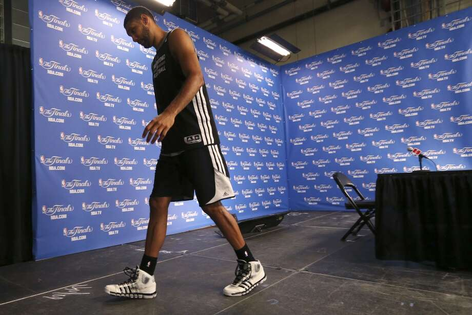 San Antonio Spurs' Tim Duncan leaves a press conference after practice at the AT&T Center, Wednesday, June 4, 2014. The Spurs will play the Miami Heat in the NBA Finals starting on Thursday in San Antonio. Photo: Jerry Lara, San Antonio Express-News