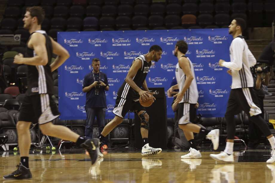 San Antonio Spurs'€™ Tim Duncan goes through drills during practice at the AT&T Center, Wednesday, June 4, 2014. The Spurs will play the Miami Heat in the NBA Finals starting on Thursday. Photo: Jerry Lara, San Antonio Express-News