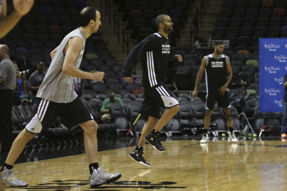 San Antonio Spurs' Tony Parker goes through drills during practice at the AT&T Center, Wednesday, June 4, 2014. The Spurs will play the Miami Heat in the NBA Finals starting on Thursday. Photo: Jerry Lara, San Antonio Express-News