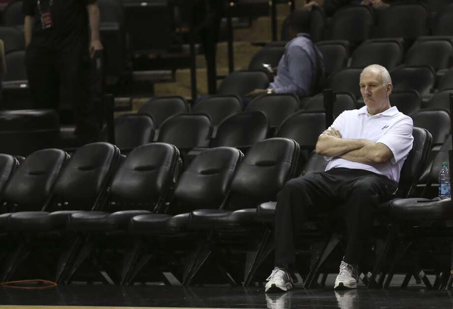 San Antonio Spurs' head coach Gregg Popovich sits during team practice at the AT&T Center, Wednesday, June 4, 2014. The Spurs will play the Miami Heat in the NBA Finals starting on Thursday. Photo: Jerry Lara, San Antonio Express-News