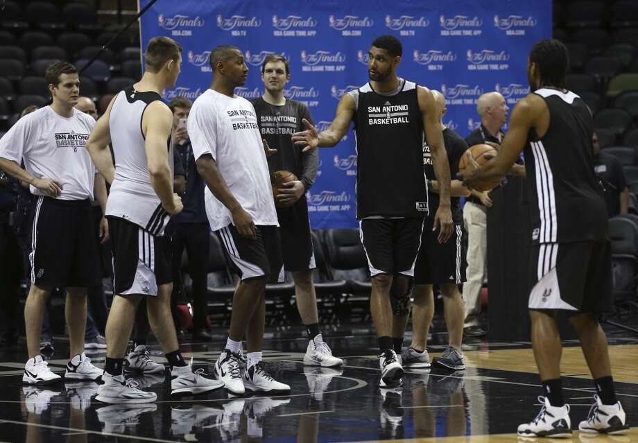 San Antonio Spurs' Tim Duncan talks with teammates during practice at the AT&T Center, Wednesday, June 4, 2014. The Spurs will play the Miami Heat in the NBA Finals starting on Thursday. Photo: Jerry Lara, San Antonio Express-News
